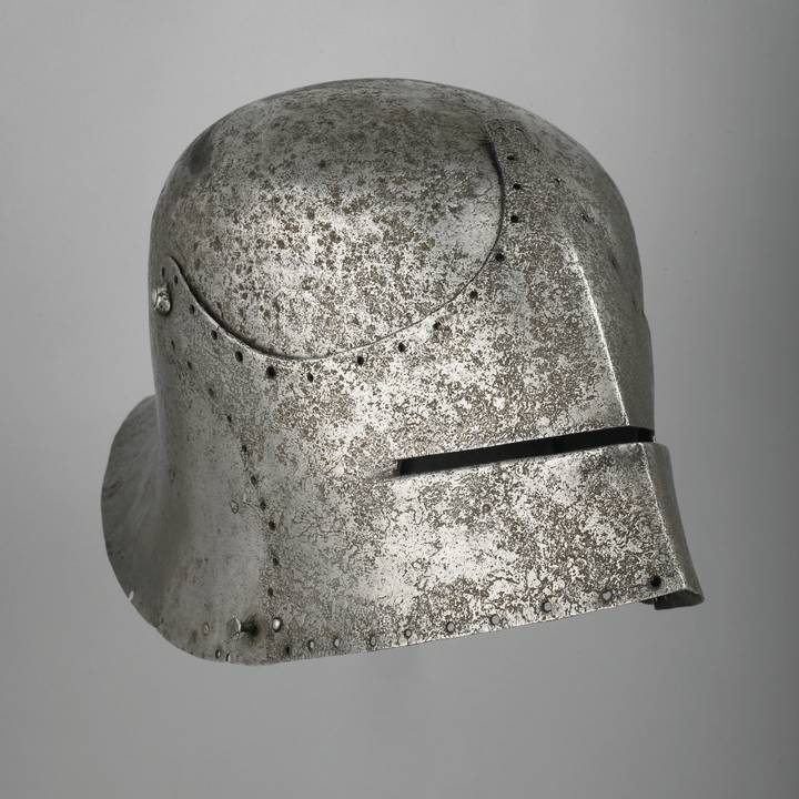 Fifteen century helmet with visor and stitching holes on visor edge