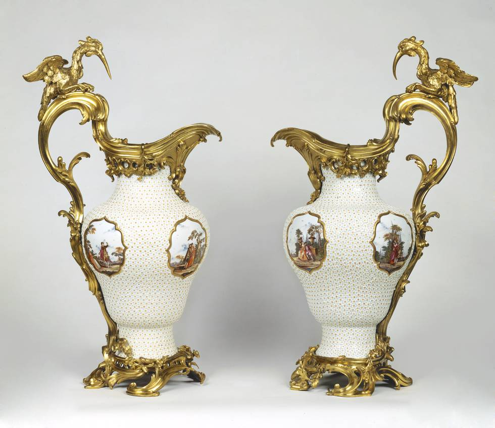 Two vases covered in low relief white flowers, gilt-bronze handles and bird