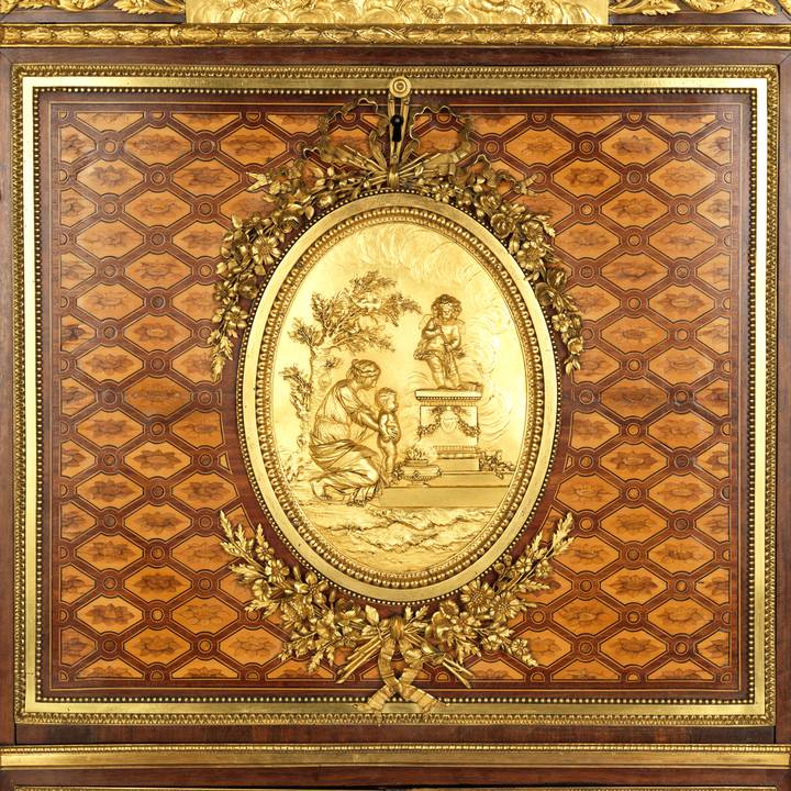 Close up of wooden furniture with gilded figures