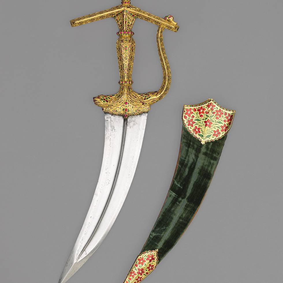 Tiger head shaped gold, jewelled dagger handle and green guard