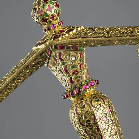 Ornate detail of gold jewelled dagger handle