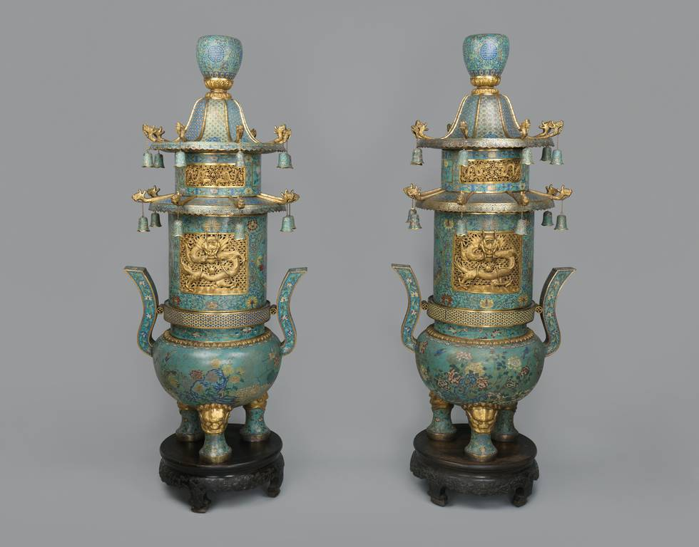Two blue and gold incense burners with dragon and flower motifs