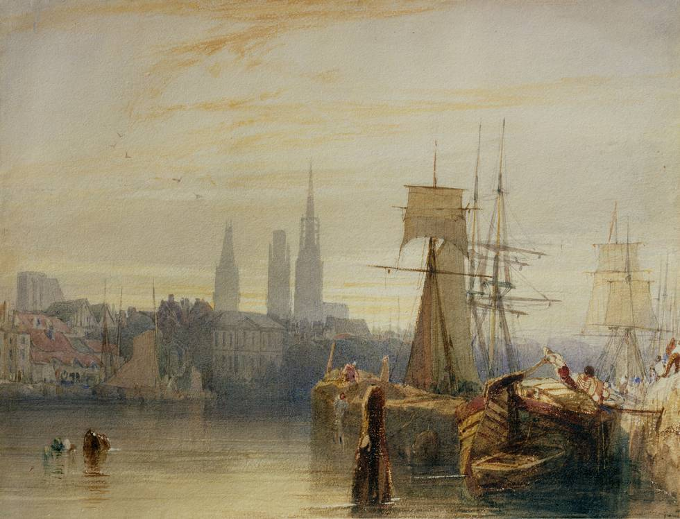 Morning scene of a city across water with boats on