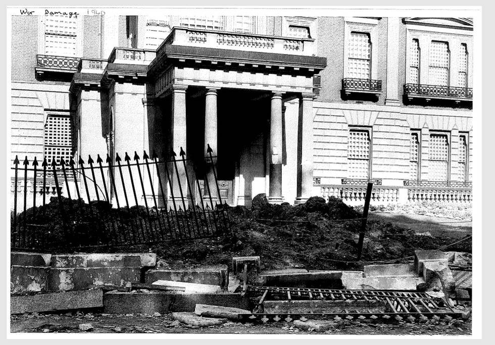 Black and white photo of front of Hertford house with bomb damage